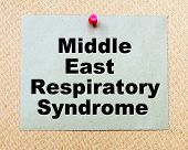 foto of respiratory disease  - Middle East Respiratory Syndrome written on paper note pinned with red thumbtack on wooden board - JPG