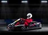 foto of karts  - Young girl karting racer at stadium - JPG