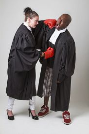 foto of toga  - woman and man in canadian lawyer toga having a boxing match - JPG