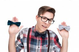 image of nerd glasses  - Young nerd in glasses and checkered shirt and bow ties isolated on white background - JPG