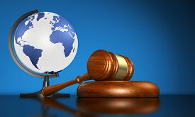 foto of human-rights  - International law systems justice human rights and global business education concept with world map on a school globe and a gavel on a desk on blue background - JPG