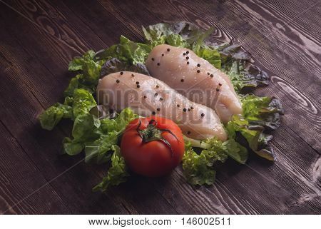 Raw Chicken Breast Fillets. Raw Chicken Breasts And Spices On Wooden Cutting Board, Close Up View.