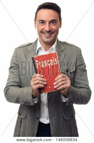Smiling Handsome Man Holds English Textbook