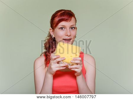 Girl With Piece Of Cheddar Cheese