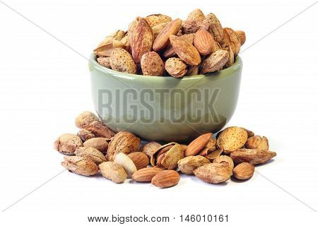 Roasted Almond nut in shell and shelled on a bowl isolated on white background