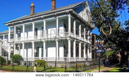 white mansion with columns in New Orleans' garden district