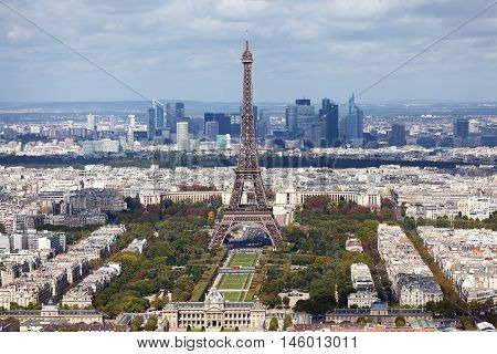 Eiffel tower as seen from Montparnasse Tower. La Defense business district seen on background.