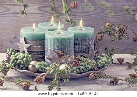 Four green christmas candles for advent