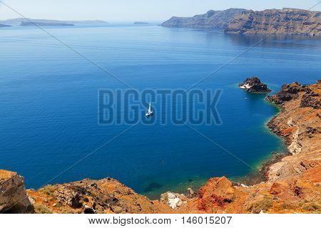 A perfect view of the volcano in Oia Santorini with blue waters of the sea