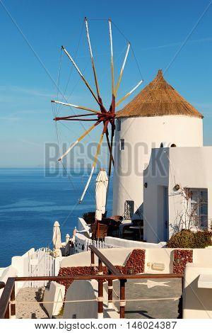 Windmill in Oia town Santorini Greece. Vertical shot