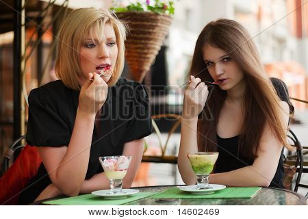 Young Women Eating An Ice Cream