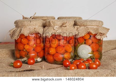 Transparent Banks With Marinated Cherry Tomatoes.