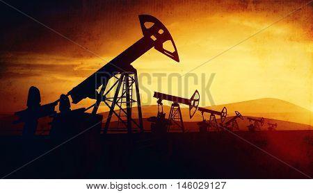 3d illustration of oil pump jacks on sunset sky background