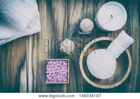 Composition of spa treatment on wooden table background