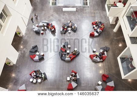 Student groups on seating in a modern university atrium