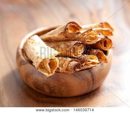 Fried bread rolls in a wooden bowl