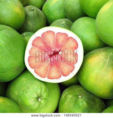 Fresh Red Grapefruit Slice On Grapefruit cut organic background