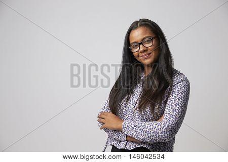 Studio Portrait Of Female Fashion Buyer Looking At Camera