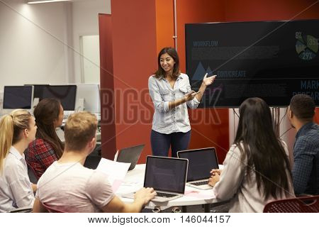 Teacher Talking To Students In College Class