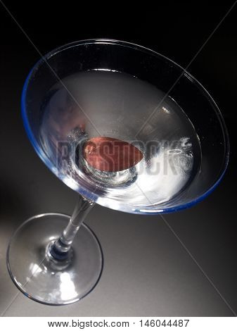 Martini cocktail isolated on black background. Tilted