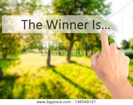 The Winner Is... - Hand Pressing A Button On Blurred Background Concept On Visual Screen.