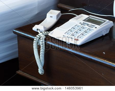 hang up white telephone on the wooden table