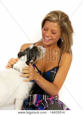 Blond girl with dog in studio