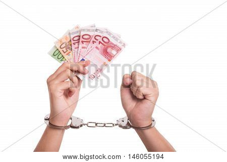 Corruption in Europe. Two hands with handcuffs and some Euro money.