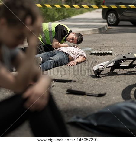 Despair young driver at road accident scene