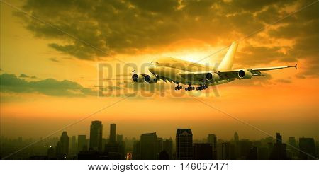 air plane flying over sky scraper and sun set sky background