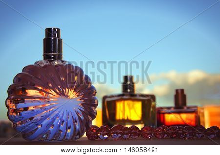 different bottle of perfume in colorful background