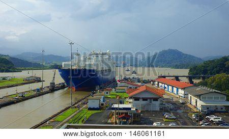 Ciudad de Panama, Panama / Panama - December 15 2014: Cargo ship passing through the Miraflores Locks at the Panama Canal