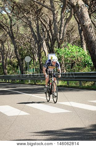Grosseto, Italy - May 09, 2014: The disabled cyclist with the bike on the road of Grosseto