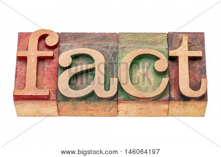 fact -isolated word abstract in letterpress wood type printing blocks stained by color inks