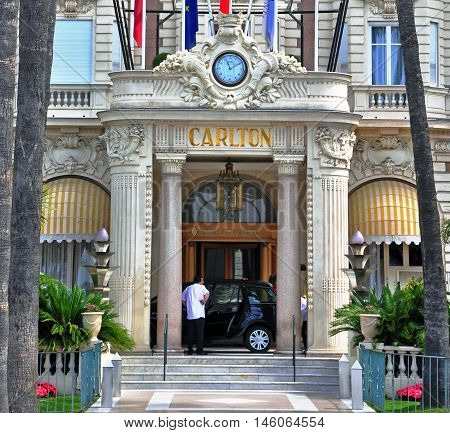 CANNES FRANCE - JUNE 18 2011: Facade of Carlton intercontinental hotel in Cannes France on June 18 2011. Carlton is luxury hotel chain around the world.