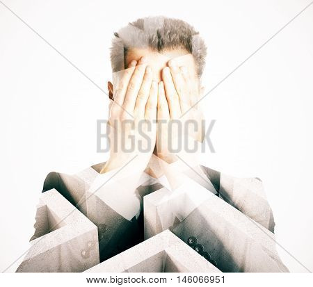 Stressed businessman covering face with hands on abstract background with maze. Business difficulty concept. Double exposure