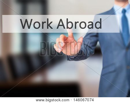 Work Abroad - Businessman Hand Pressing Button On Touch Screen Interface.