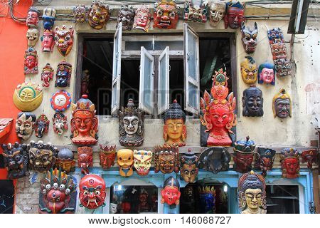 KATHMANDU, NEPAL - APRIL 2014 : Different types of wooden mask hanging on external wall in Kathmandu, Nepal on 12 April 2014. These are masks of Hindu deities, god, goddess, Buddha.