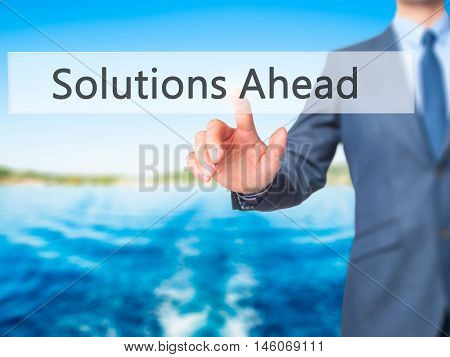 Solutions Ahead - Businessman Hand Pressing Button On Touch Screen Interface.