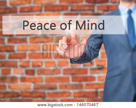 Peace Of Mind - Businessman Hand Pressing Button On Touch Screen Interface.