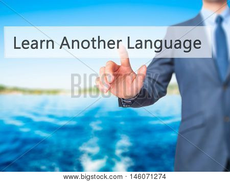 Learn Another Language - Businessman Hand Pressing Button On Touch Screen Interface.