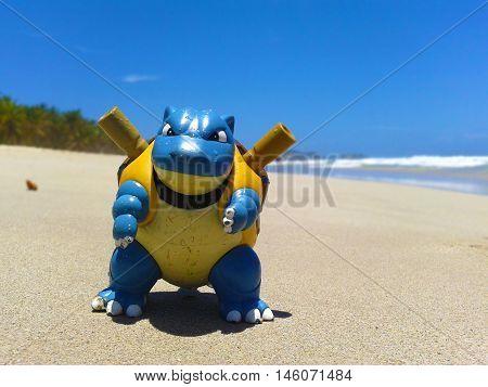 Nueva Esparta, Venezuela 07 september 2016. little toy of  the caracter blastoise from the anime pokemon on the beach sand looking like a real wild pokemon