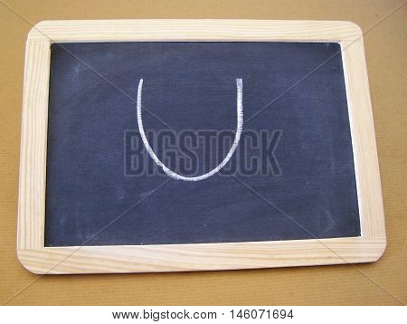 Slate used by students in the preparatory work - letter U