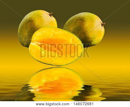 Two Mangoes And One Cut Mango Reflecting