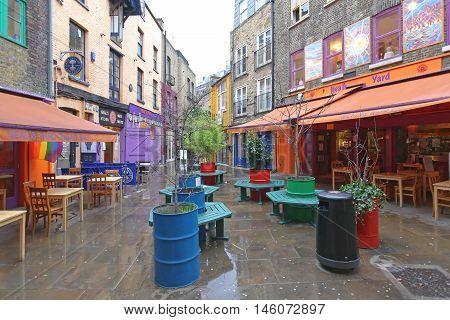 LONDON UNITED KINGDOM - JANUARY 28: Neals Yard Alley in London on JANUARY 28 2013. Neals Yard Hidden Passage Near Covent Garden in London United Kingdom.