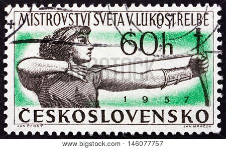 CZECHOSLOVAKIA - CIRCA 1945: a stamp printed in Czechoslovakia shows Woman Archer International Archery Championships circa 1945