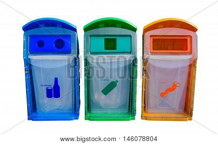 Different colored recycle bins isolated on white background. Waste management concept