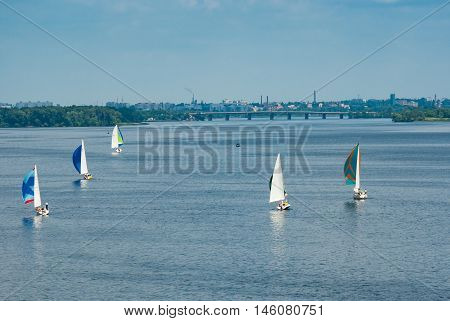 DNEPROPETROVSK UKRAINE - MAY 29, 2010: Sailing race on the Dnepr river during city yacht club championship in Dnepropetrovsk, Ukraine at May 29, 2010