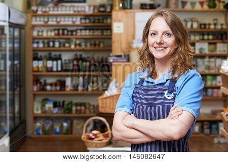 Portrait Of Smiling Woman Working In Delicatessen
