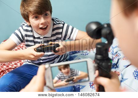 Two Boys Recording Gaming Blog In Bedroom